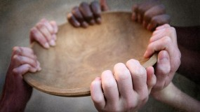 Hands holding up an empty bowl